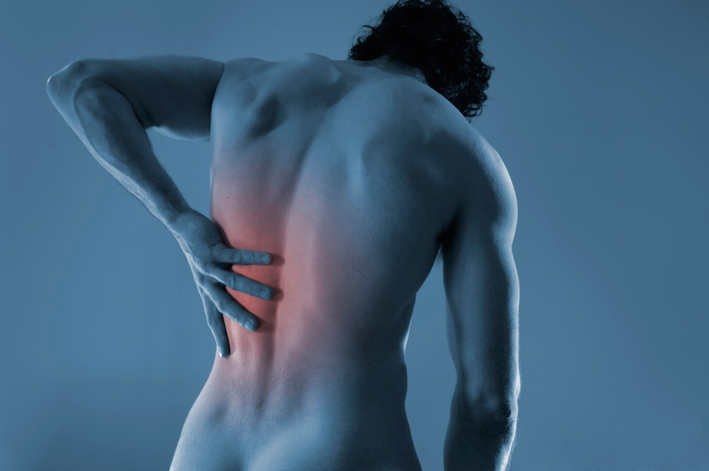man with back pain before seeing Tustin Chiropractor