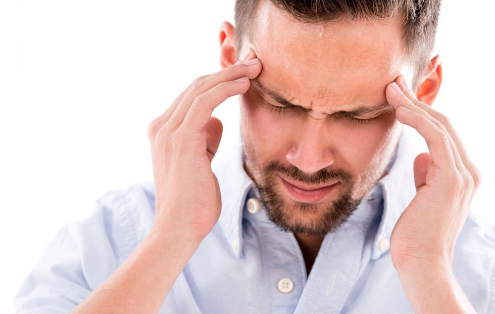 man with headache or migraine before seeing a tustin chiropractor for pain relief