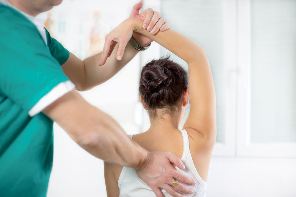 woman being treated for upper back pain by an Irvine Chiropractor